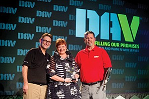 DAV National Employment Director Jeff Hall (left), Jan Jones, president and CEO of The Elizabeth Hospice, who accepted the Outstanding Midsize Employer of the Year award at DAV's national convention in New Orleans presented by DAV National Commander Dave Riley (right). Photo courtesy of Elizabeth Hospice