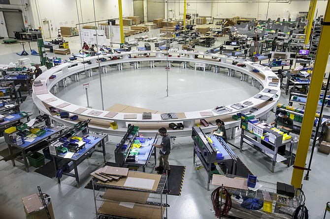 LED fixtures are assembled using circular conveyor system at Vision Engineering in Palmdale.