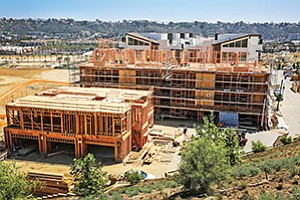 Multifamily housing permits are expected to fall well short of totals from the past two years, below what is projected for meeting the needs of population growth. Construction shown here is at the Shea Homes Lucent II site in the Civita development in Mission Valley.