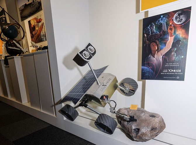 Out of This World Ambition: Display touting the Google Lunar X Prize competition, which has a $30 million purse, at the Culver City office of the X Prize Foundation.