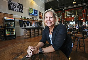 Candace Moon, shown here at AleSmith Brewing Company in Miramar, founded the firm Craft Beer Attorney in 2009 and built the client base to 350. She and her staff of three have joined the local office of Cincinnati-based Dinsmore & Shohl LLP.