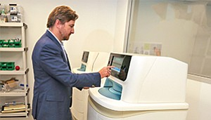 TruMed CEO and President Jesper Jensen demonstrates the company's AccuVax, a high-tech vaccine management system.