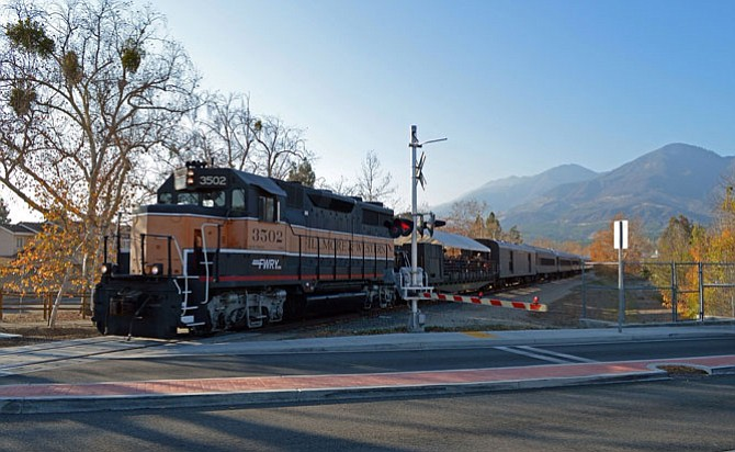 Right of Way: Fillmore & Western locomotive at grade crossing.