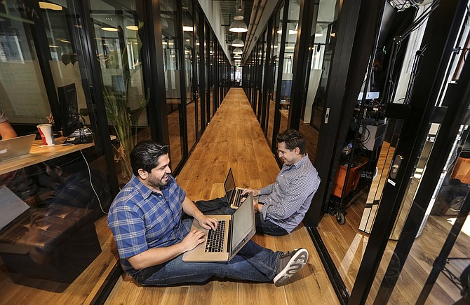 Entrepreneurs work at WeWork San Diego. Photo by Jamie Scott Lytle.