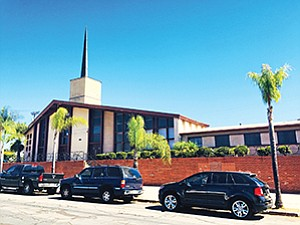 America's Finest Charter School plans to open a new charter high school, after recently purchasing this former Universal Church building in San Diego. Photo courtesy of QFC Real Estate