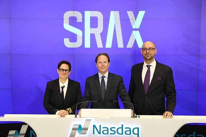 Social Reality Chief Executive Christopher Miglino flanked by Chief Innovations Officer Erin DeRuggiero, left, and Chief Operating Officer Kris Nelson