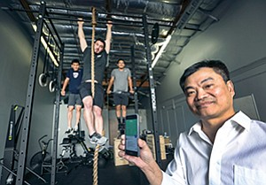 FitTech's CEO Tien Nguyen, front right, and co-founders Ton Nguyen, left, Matthew Paiz, and Khang Nguyen put a little 'sweat equity' into their work at the company lab in Poway.