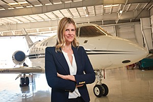 Kimberly Herrell vice president at Carlsbad-based Schubach Aviation stands in a hangar at McClellan-Palomar Airport. Schubach manages 17 aircraft for private owners and makes 12 available for charter.