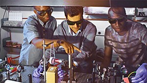 Boubacar Kanté, left, Babak Bahari and Abdoulaya Ndao demonstrate new laser technology at UC San Diego's Jacobs School of Engineering. Photos courtesy of Jacobs School of Engineering/UC San Diego