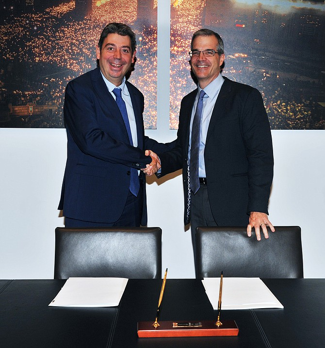 Eloi Planes, executive president of Fluidra, and Bruce Brooks, CEO of Zodiac, shake hands at a recent meeting in Barcelona. Photo courtesy of Fluidra.