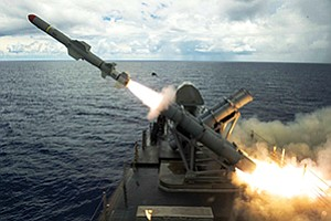 A Harpoon missile launches from the missile deck of the San Diego-based littoral combat ship USS Coronado near Guam in the Philippine Sea in August. An autonomous Fire Scout helicopter helped direct the missile to its target. Photo by MC2 Kaleb R. Staples, courtesy of U.S. Navy
