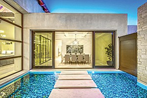 The luminous reflecting pools off of the dining area with floating limestone stepping stones to a courtyard.