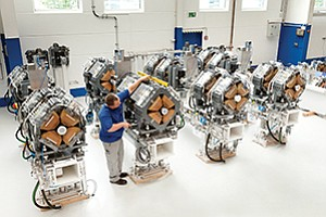 A man sets up proton machines in 2014, ahead of the launch of a San Diego proton treatment center that recently rebranded as California Protons amid new ownership. Photos courtesy of California Protons