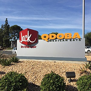 The monument sign at Jack in the Box headquarters in Kearny Mesa will have to change as the San Diego-based corporation announced plans to sell its Qdoba restaurant subsidiary for $305 million.