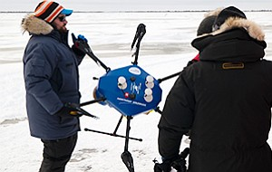 Northrop Grumman engineers work with an unmanned aircraft designed to document polar bear habitat on Hudson Bay in Canada. Photo courtesy of Northrop Grumman Corp.