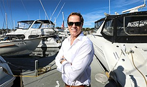 Above: Activity in and around San Diego Bay.  Below: Eric Pearson, co-owner of Crow's Nest Yachts San Diego, stands near some of the yachts his company is selling.