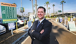 Keith Jones is co-owner and managing partner of Ace Parking. The longtime San Diego business oversees parking service at San Diego International Airport as well as some less obvious venues — such as the resorts on the Las Vegas Strip. Above right, Ace Parking collects the fees of people who bring their cars to San Diego International Airport and other San Diego venues.
