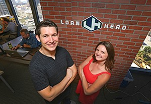 Kristin Slink and Derek Barclay, founders of LoanHero, pose for a photo in their office in downtown San Diego in 2016. The company recently announced it has been acquired by a lending company in Georgia.