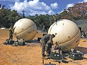 U.S. Marines work with two inflatable satellite dishes from GATR Technologies. Photo courtesy of Cubic Corp.