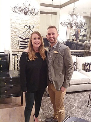 Emily Wilson Hassig, left, chief development officer for Promises2Kids, and Michael Babcock, store manager of ARHAUS, during the furniture store's grand opening event.  Photo courtesy of Promises2Kids