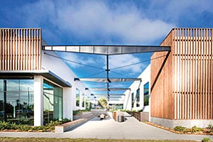 The Make office campus, on Avenida Encinas in Carlsbad, is home to a number of tech companies. The complex was developed to encourage interaction between employees of various companies and improve workers' work-life balance, with an assortment of amenities including a gym, cafe, bike locker and surf shower. Photo courtesy of Cruzan
