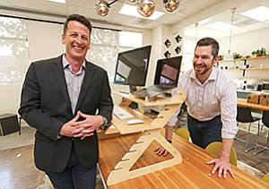 Readydesk co-founders Joe Nafziger (at left) and Ben Larson designed their desktop conversion unit for people who are interested in standing while they work. They have sold more than 8,000 units since launching the company in 2014.