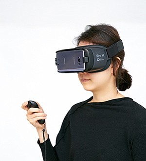 A model wears a Samsung Gear VR headset, which uses a Galaxy smartphone to display an image that appears to be in three dimensions. Photo courtesy of Samsung
