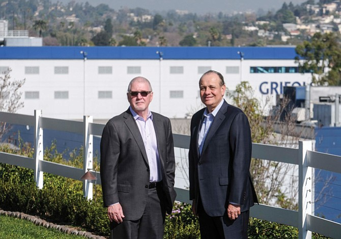 Grifols Biologicals Chief Executive Willie Zuniga, right, with Gregory G. Rich, chief executive of Grifols Shared Services