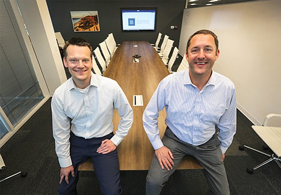 Signature Analytics founder and President Jason Kruger, left, and the company's CEO Peter Heald are expecting a good year in 2018. The company added 30 employees last year.