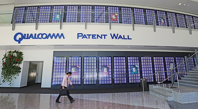 It's hard to miss the two-story patent wall in Qualcomm Inc.'s headquarters lobby. Qualcomm has 130,000 patents issued or pending. The bulk of the corporation's earnings come from other companies paying Qualcomm for permission to use its intellectual property.