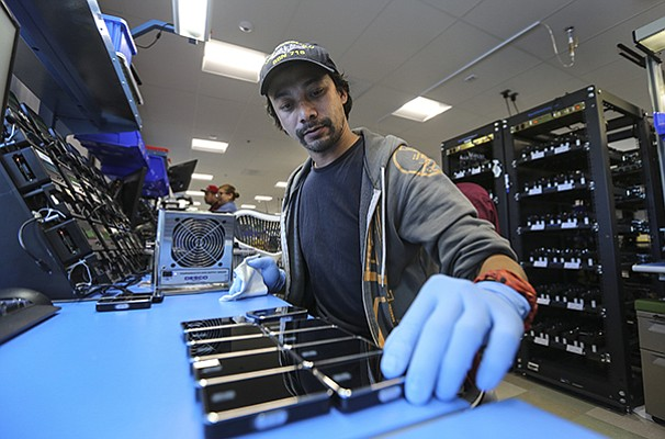 Charmaigne Obillo of Tandem Diabetes Care inspects cartridges at the manufacturing plant in San Diego.