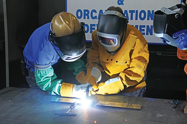 Welders install a section of keel at the General Dynamic-NASSCO shipyard in 2016. The company announced in March it will be hiring 800 to 1,000 workers now through fall of this year to fulfill contracts to build eight new ships through 2024. Photo courtesy General Dynamics NASSCO
