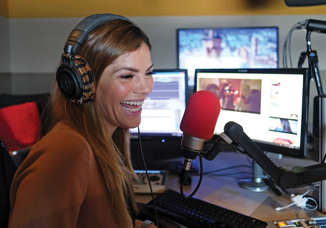 On Air: Donaji Esparza in a DJ booth at Univision's KLEV studio.