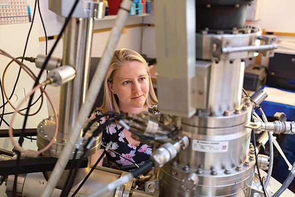 Emily Mathison, lab manager at General Atomics' Inertial Fusion Technology (IFT) Analytical Services Lab performs a test using an Auger Electron Spectroscopy instrument. The lab is opening its doors to San Diego's businesses. Photo courtesy General Atomics