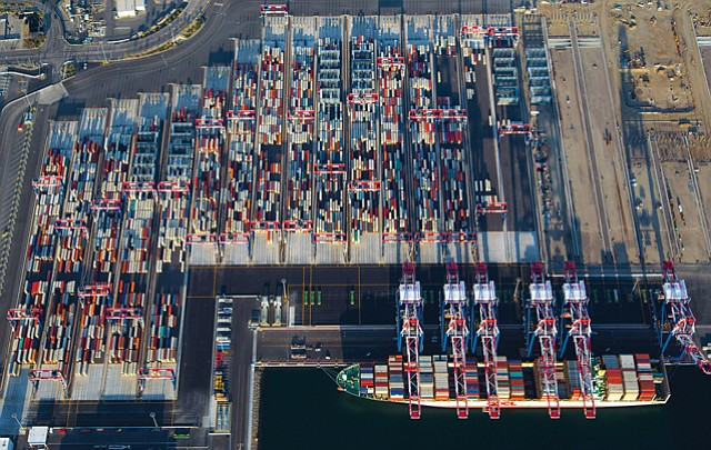 Foreign Concern: A terminal at the Port of Long Beach's Pier E has become a flashpoint for federal regulators reviewing Cosco Shipping's acquisition of Orient Overseas.