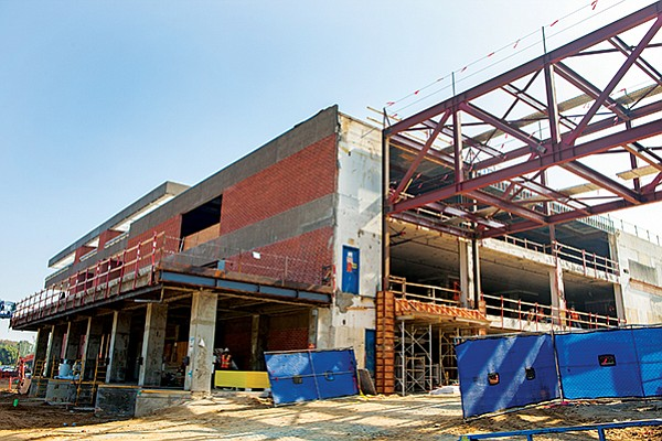 A booming construction industry in San Diego and elsewhere is putting pressure on the cost of doing business. Shown in this file photo is Ampersand under construction, the renovated former Mission Valley campus of The San Diego Union-Tribune.