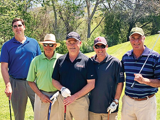 Grant Kuhn, senior account manager at Commpedia, left, Dana Roberts, Rich Freeark, Ryan Stichler, all with C.W. Driver Cos.; and Joe Grosshart, president of Good & Roberts at C.W. Driver's third annual golf charity tournament. Photo courtesy of C.W. Driver Cos.