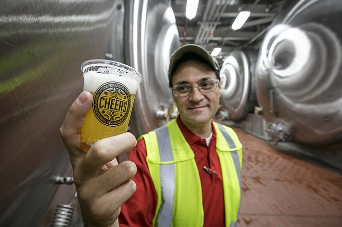 Taste Test: Senior Brewmaster Jeff Jenkins with cup of beer-in-progress.