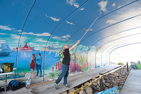 Artist Kevin Anderson at work on a tunnel mural in Sudberry Properties' Civita development. Photo courtesy of Foley Development