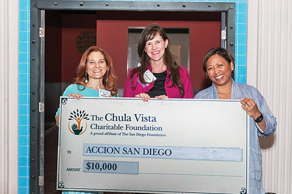 Elizabeth Schott of ACCION San Diego, center, accepts a grant check from Chula Vista Charitable Foundation board members Lisa Moctezuma, left, and Debbie Espe, right. Photo courtesy of the Chula Vista Charitable Foundation