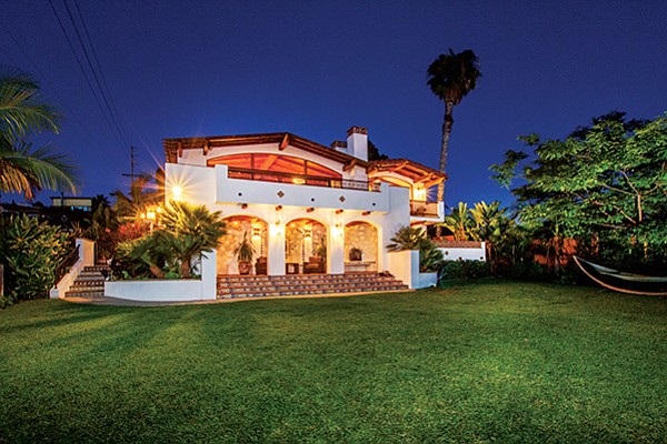 The rear view of a home at 354 Glenmont Drive in Solana Beach at dusk. Photo courtesy of Coldwell Banker Global Luxury