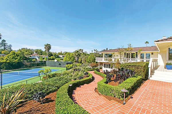 The brick driveway leading to a home at 5826 Lago Lindo in Rancho Santa Fe. Photo courtesy of Compass