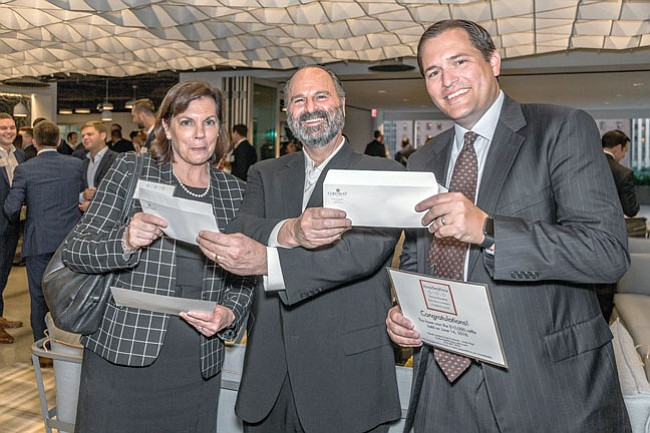 Build-your-own Lego version of Citigroup Center winners: Thomas Ricci of Coretrust Capital (center) with Lynn Kious (left) and Matt Perrigue (right).