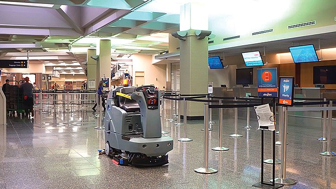 A floor scrubber with Brain Corp. technology navigates San Diego International Airport autonomously. The San Diego company partners with manufacturers of floor cleaning machines to turn the equipment into robots. Photo courtesy of Brain Corp.