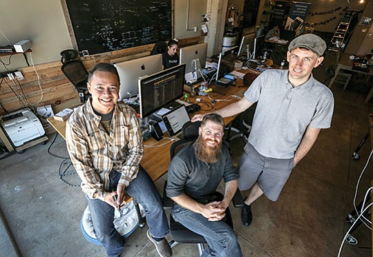 From left, Edge co-founders Paul Puey, Kevin Sullivan and William Swanson work out of an office in downtown San Diego. The office also hosts meetups for local bitcoin enthusiasts. Edge has developed a multicurrency mobile wallet and data security platform.
