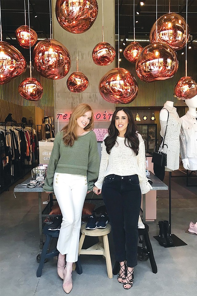 Curio Co-founders: Outram, Khouri at Reservoir, a boutique in Culver City that's signed up with the app.