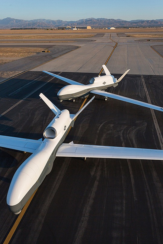 Two U.S. Navy Triton aircraft share a taxiway in the California desert. Australia plans to buy six of the high-flying unmanned aircraft, taking delivery of all by the mid-2020s. Photo courtesy of Northrop Grumman Corp.