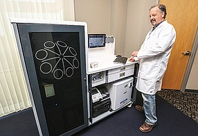Rick Hockett, chief medical officer of Genalyte, demonstrates the company's mobile blood testing technology. Genalyte is among the San Diego blood companies that have differentiated themselves in the wake of disgraced Theranos.
