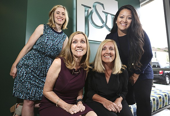 From left, Jackie Isidore, Donna Vargo, Naomi Lohnes and Ashly Ortiz outside the Kearny Mesa office of Johnson & Jennings.