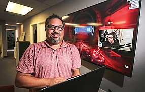 Online Performers Group's CEO Omeed Dariani in his Point Loma office. Below,